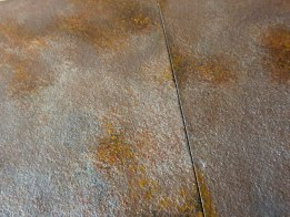 detail of the 'rusted' countertop in the hunters man cave by Ellen Leigh