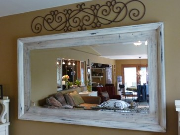 Plain mirror frame distressed and glazed by Ellen Leigh