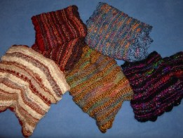 Colorful and knitted scarves using a variety of different yarns and stitches by Ellen Leigh.