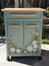 Decorative floral painting on kitchen cart by Ellen Leigh