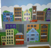 A cartoonish town for the young 5's at the day care. Mural by Ellen Leigh.