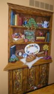 China Cabinet filled with family favorite items. Mural by Ellen Leigh