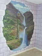 Stone block walls on two walls broken away to reveal a princess tower, mountains and a waterfall. Every little girl wants this. Mural by Ellen Leigh