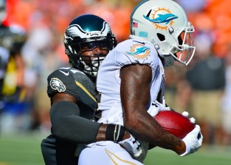 Jarvis Landry of the Miami Dolphins being tackled