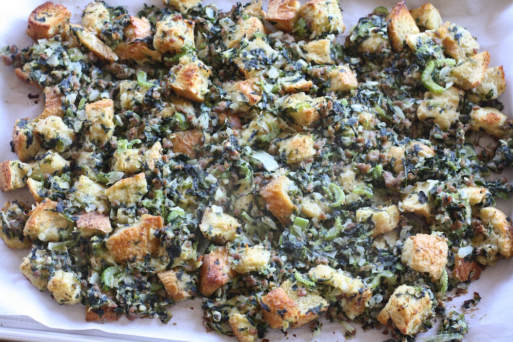Julia Turshen's Sheet Pan Bread Stuffing with Sausage + Spinach | St. Louis Family and Lifestyle Blogger Liz of Ellie And Addie shares the best stuffing recipe for Thanksgiving