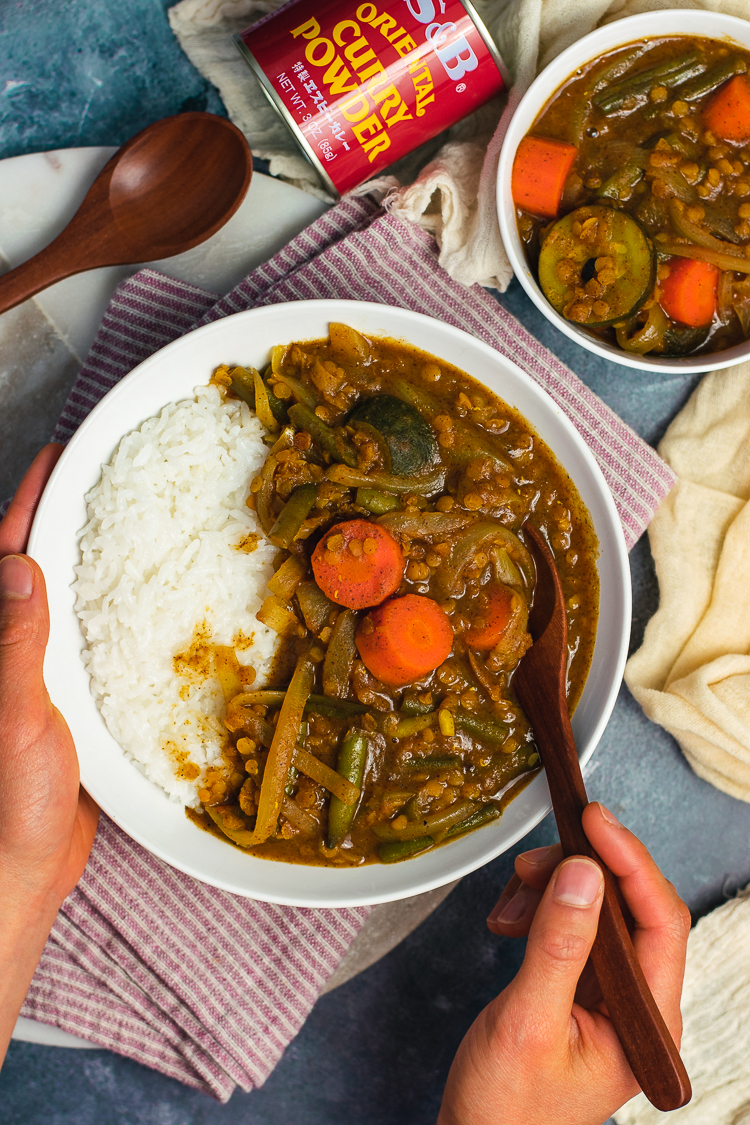 vegan japanese curry served in bowl with rice and spoon