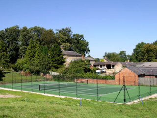 Farm setting for a hard tennis court by EnTC - Elliott Courts