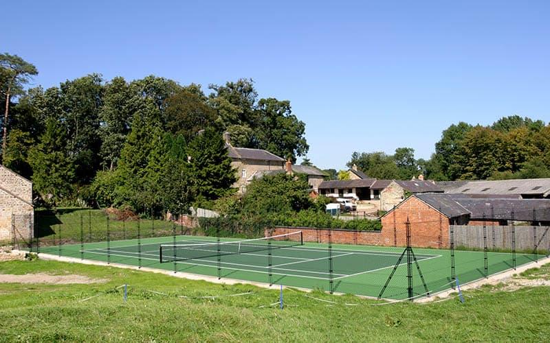 Farm setting for a hard tennis court by EnTC - Elliott Courts