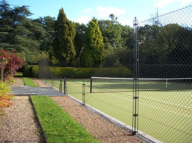 EnTC Tennis Courts replacing hedges with fences encourages air flow and keeps the court dry.