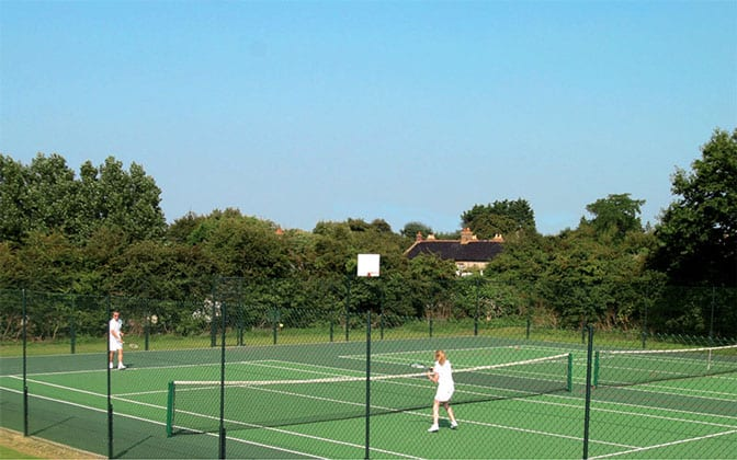 Tarmac tennis courts with a Pladek surface from Elliott Courts.