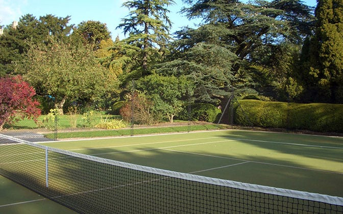 Tennis court fencing from EnTC merges into a green background