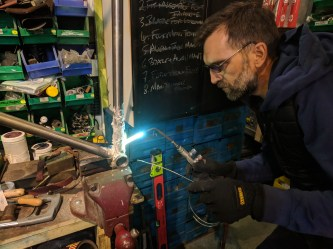 Brazing the down tube to the bot. bracket