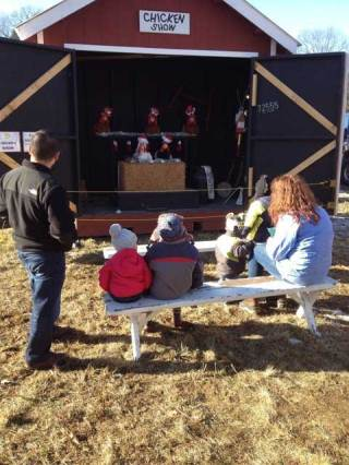 Families enjoying the fun chicken show at Ellm's Family Farm near Saratoga.