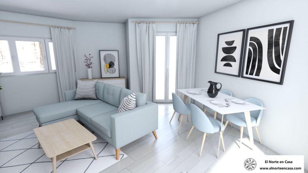 Salón comedor en blanco y gris con la zona de comedor de estilo escandinavo y sillas en gris