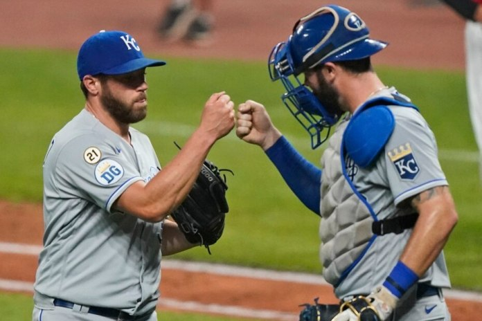 Greg Holland (left) and Cam Gallagher of the Kansas City Royals have Clemente's uniform number affixed to the sleeve of their shirts.