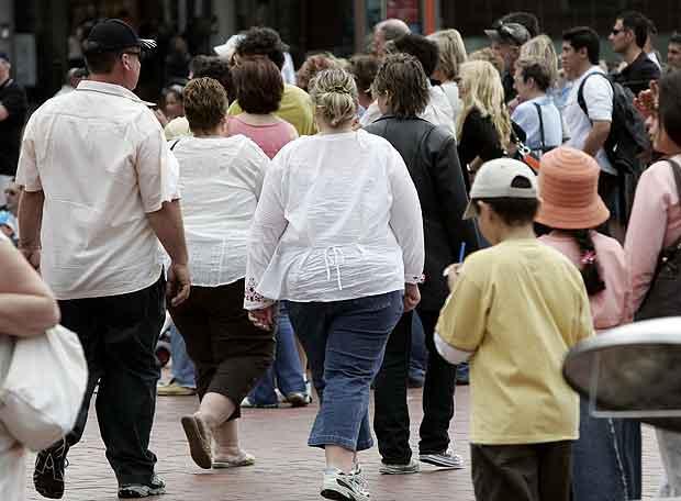 Varios obesos por una calle de Sidney- ASSOCIATED PRESS