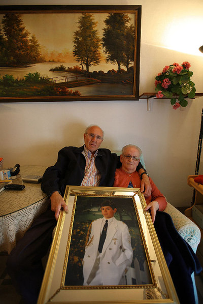 Manuel Espí and María Martínez with Picture of Lucas