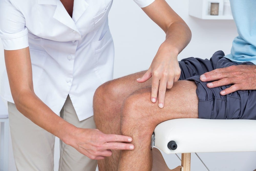 Image of a doctor using physical therapy to treat a patient's sciatica.