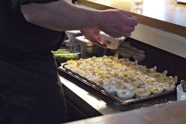 Putting the final touches on mini lemon meringue pies