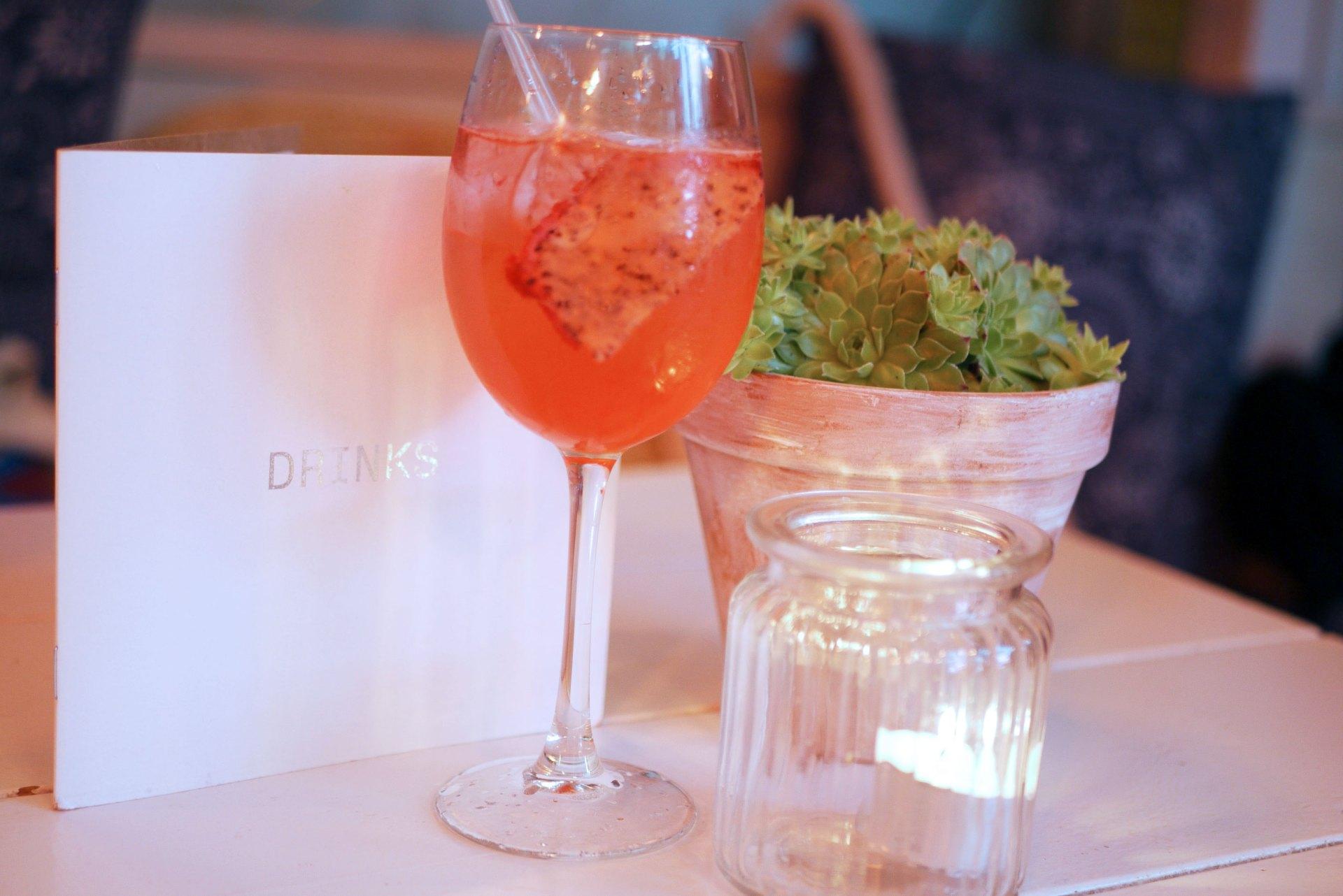 Australasia Spritz - Rose liqueur, plum sake, lemon juice, plum bitters and sparkling rosé