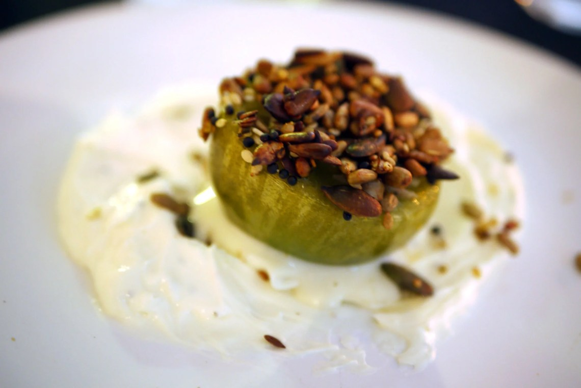 Grilled kumato tomato with a savoury granola crust on whipped mascapone