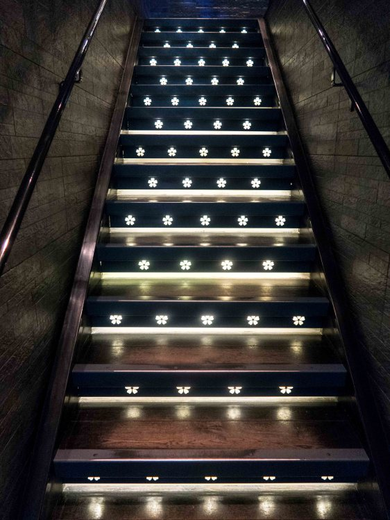 Stairs leading up to the restaurant area at Tattu