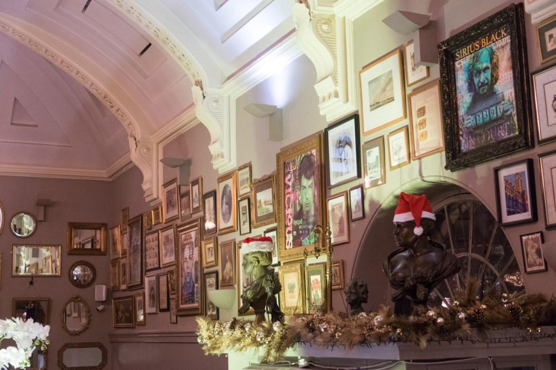 Santa hats on the busts above the restaurant door