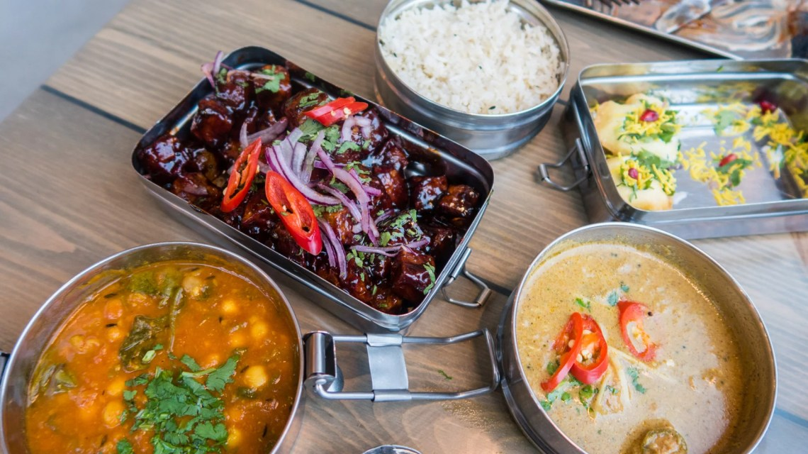 Front right: Mother Butter Chicken £7.95, Middle Back: Mowgli Basmati Rice £2.50