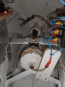 The propshaft alternator puts out ac volts which are converted to dc by the bank of rectifiers on the right before going into a charge controller and onto the batteries.