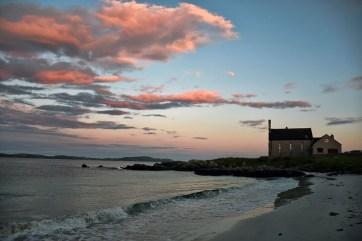 Zonsondergang strand Iona Schotland