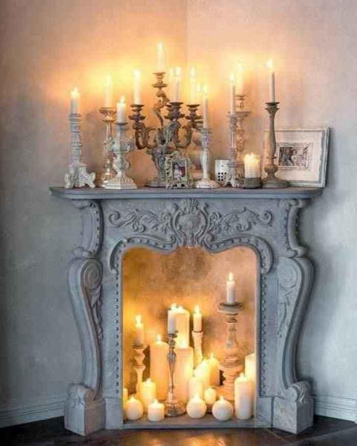 decora con velas chimenea