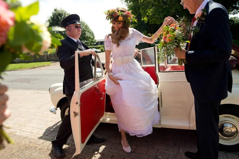 english countryside barn wedding bride arrives church