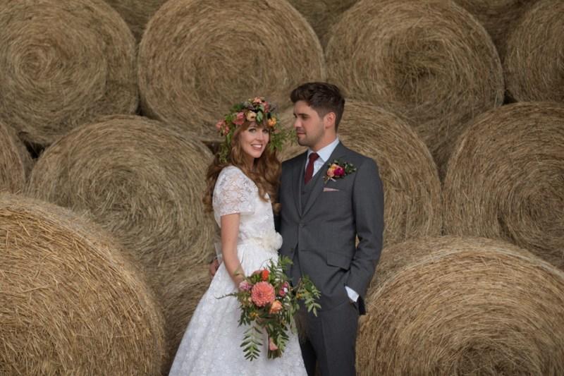 english countryside barn wedding bride groom portraits hay bales farm flower crown