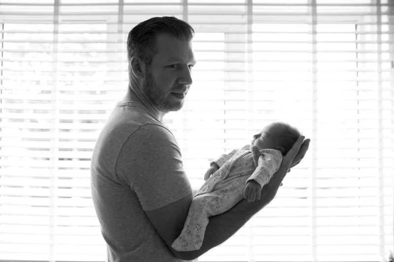 natural newborn family photography daddy daughter silhouette