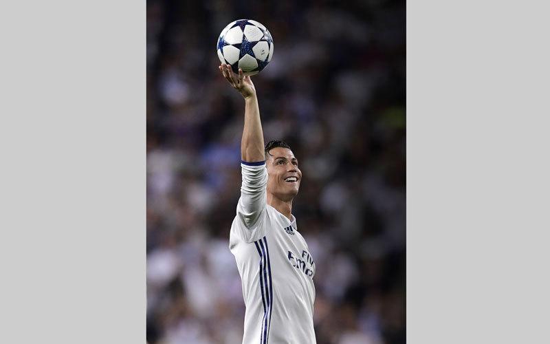 رونالدو يأمل قيادة ريال مدريد لتحقيق إنجازات جديدة في الموسم المقبل. أ.ف.ب