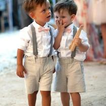 Adorable Ring Bearers In Loafers, Suspenders, And Bow Ties