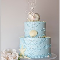 An Ocean Blue Beach Themed Wedding Cake By The Pastry Studio