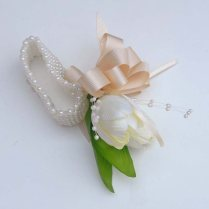 Spring Themed Ivory Tulip Wrist Corsage On A Pearl Band