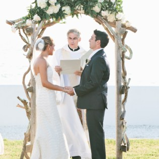 Curly Wood Wedding Arbor With White Floral Garland