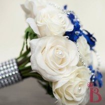 Ivory Roses Bouquet With Royal Blue And Silver Accents