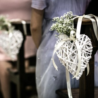 Lovely Decor For A Church Ceremony With Heart And Baby Breath
