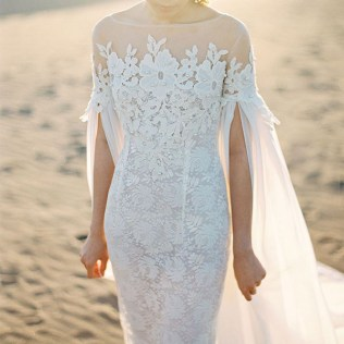 A Statement Trend 19 Amazing Wedding Dresses With Capes