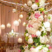 Wedding Centerpiece With Branches And Hanging Votives