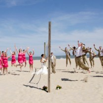 Fun Beach Wedding Party Portraits From A Hot Pink, Beach Themed