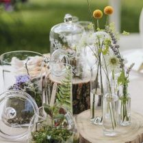 Jars Full Of Succulents And Wildflowers Wedding Centerpieces