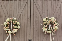 The Barn Doors Were Dressed Up With Romantic Wreaths Made From