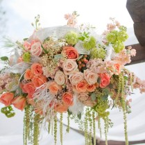 Outdoor Wedding Ceremony Arbor With Peach, Ivory And Blush Pink