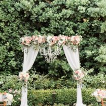 Wedding Ceremony Arch With Draping Fabric And Chandelier