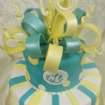 Two Tier White, Aqua Blue, And Yellow Fondant Girl's Sweet…