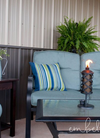 Creating a cozy seating area on a barn porch. However, these ideas will work on any porch or patio!